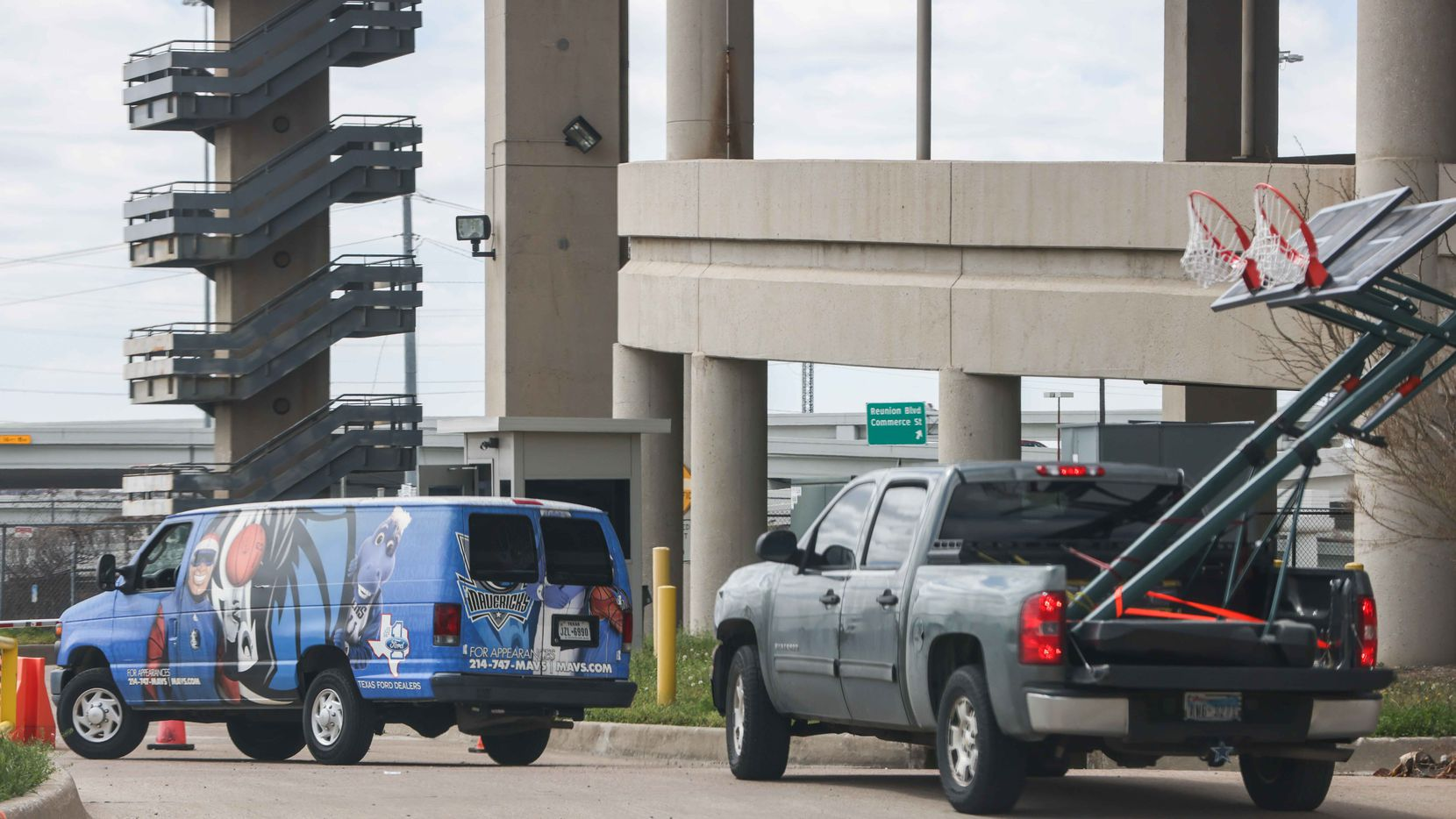 A van identified with NBA team Mavericks logo, arrives along with a pickup carrying two basketball hoops to the Kay Bailey Hutchison Convention Center in Dallas on Thursday, March 18, 2021, where 200 unaccompanied immigrant children arrived Wednesday evening. The U.S. Department of Health and Human Services confirmed Tuesday that the convention center will serve as an emergency intake site to hold teens who have arrived at the U.S.-Mexico border to decrease overcrowding at Customs and Border Protection facilities. (Lola Gomez/The Dallas Morning News)
