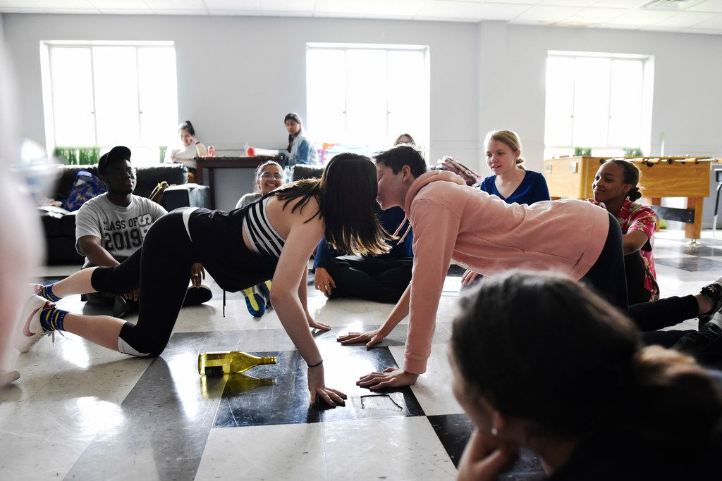 """Brooke Schlegel and Mackenzie Hameline, both 16, kiss during a spin-the-bottle scene at a rehearsal of Sex Ed. Produced by Cry Havoc Theater Company, the """"devised"""" work is based on the teens' own experience with sexual education in the schools."""