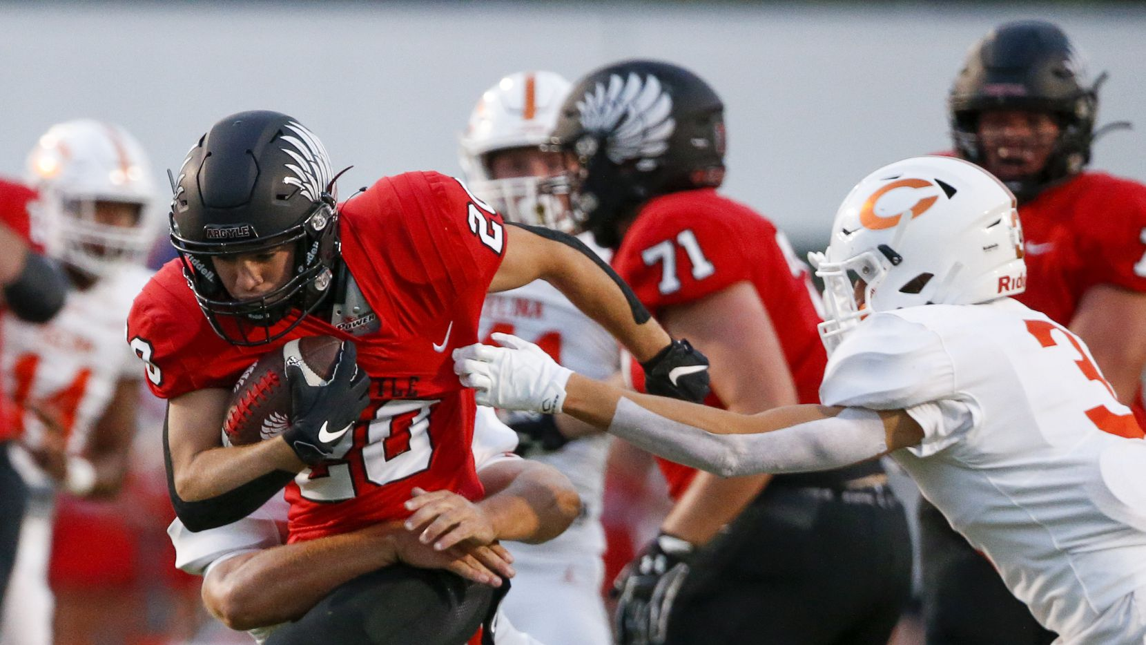 Argyle running back Landon Farris (20) is tackled by Celina linebacker Zach Veverka (34) as defensive back Jasmison Driver (3) closes in on the play during the first half of a high school football game on Friday, Sept. 10, 2021, in Argyle, Texas. (Elias Valverde II/The Dallas Morning News)