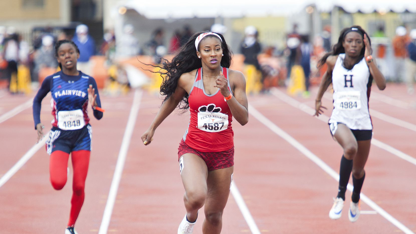 Rockwall Heath's Morgan Burks-Magee, Mesquite Horn's Kaylor Harris, and Plainview's Kaizha Roberts (cq) compete in the Division 2 of the Girls 100 meter dash prelims during the Texas Relays at the Mike A. Myers Stadium in Austin, Texas on April 1, 2016.