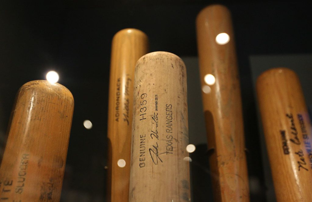 The bat (center) that Texas Rangers slugger Josh Hamilton used to hit four home runs in one game against Baltimore is on exhibit at the Baseball Hall of Fame in Cooperstown, NY, photographed on Tuesday, May 30, 2017. (Louis DeLuca/The Dallas Morning News)