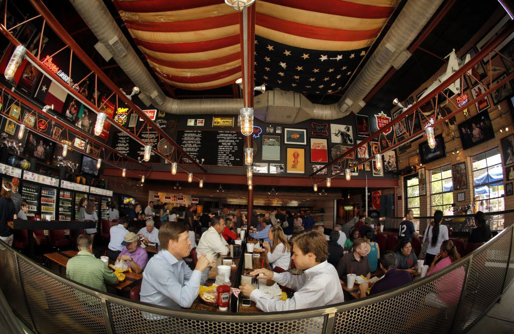 Lunch-time burger lovers fill the dining room of Off-Site Kitchen in Trinity Groves.