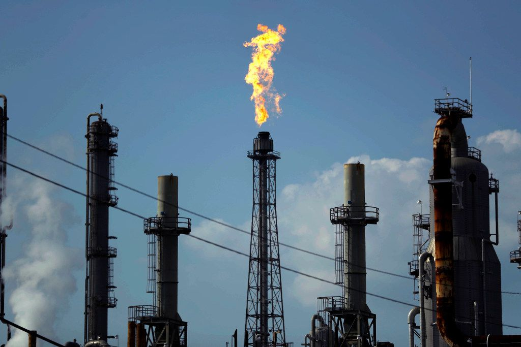A flame burns at the Shell Deer Park oil refinery in Deer Park. (Gregory Bull/The Associated Press)