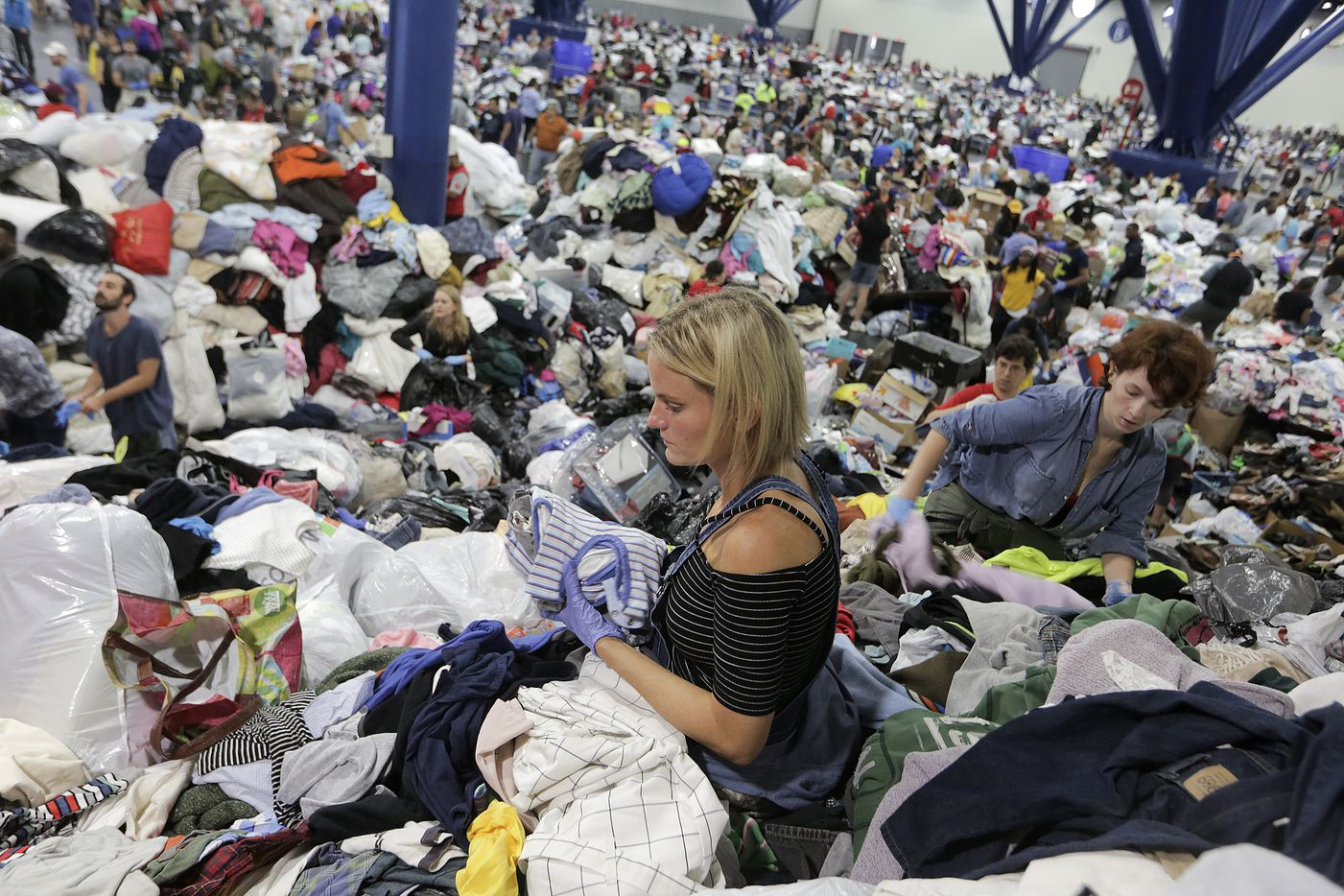 Kathryn Loder sorts donated clothing at George R. Brown Convention Center in Houston as Tropical Storm Harvey inches its way through the area on Tuesday, Aug. 29, 2017