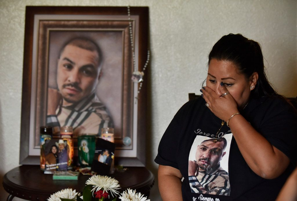 Vanessa Olguin wipes away tears as she speaks about her husband's death at their house in southern Dallas.