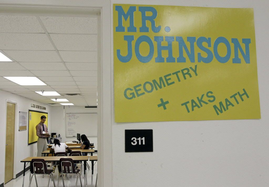 Math teacher Trey Johnson talked with students in his classroom during the first day of classes at Dallas ISD's overage school, John Leslie Patton Jr. Academic Center, when it opened in the fall of 2010. The district closed the campus, located at Nolan Estes Plaza, just off R.L. Thornton Freeway in Dallas, at the start of the 2019-20 school year.