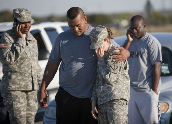 Sgt. Fanuaee Vea (left) embraces Pvt. Savannah Green outside Fort Hood on Nov. 5, 2009.  Army Maj. Nidal Malik Hasan is accused of killing 13 people and wounding 30 others in a shooting rampage on the Central Texas military base.
