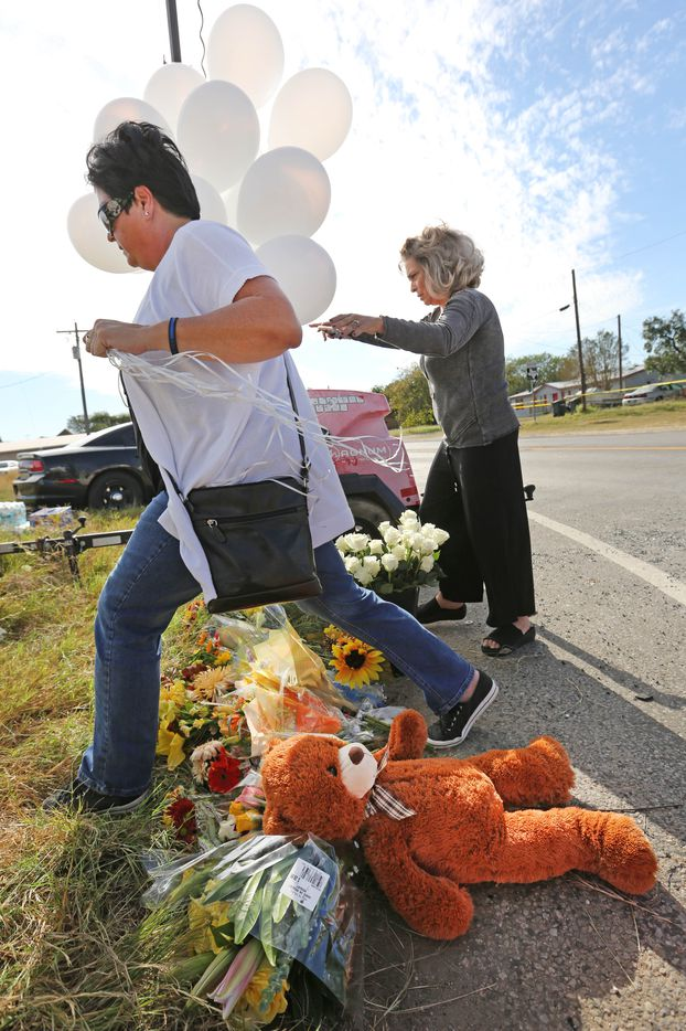 Michelle Trigo, left ,and Malinda Lamford of San Antonio deliver 26 balloons, flowers, and a stuffed teddy bear to the First Baptist Church of Sutherland Springs.