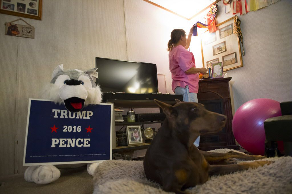 """At home, Tamara Estes looks at her dog show awards and photos, reflecting on when """"it was a happier time in life."""" Linda Davidson/The Washington Post"""