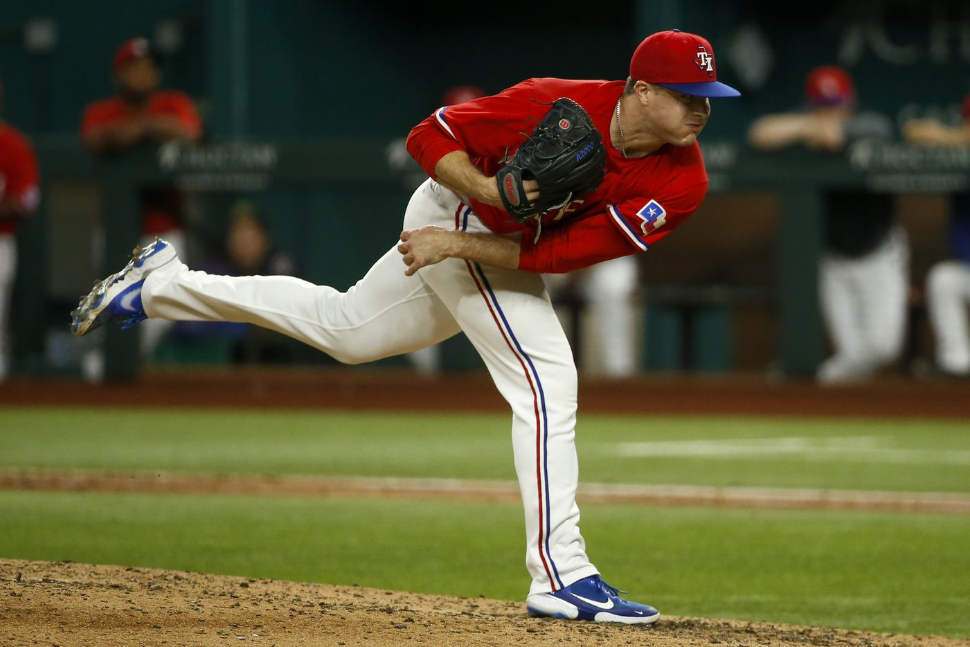 Texas Rangers relief pitcher John King (60) throws the ball during the eighth inning against the Kansas City Royals at Globe Life Field on Friday, June 25, 2021, in Arlington. (Elias Valverde II/The Dallas Morning News)