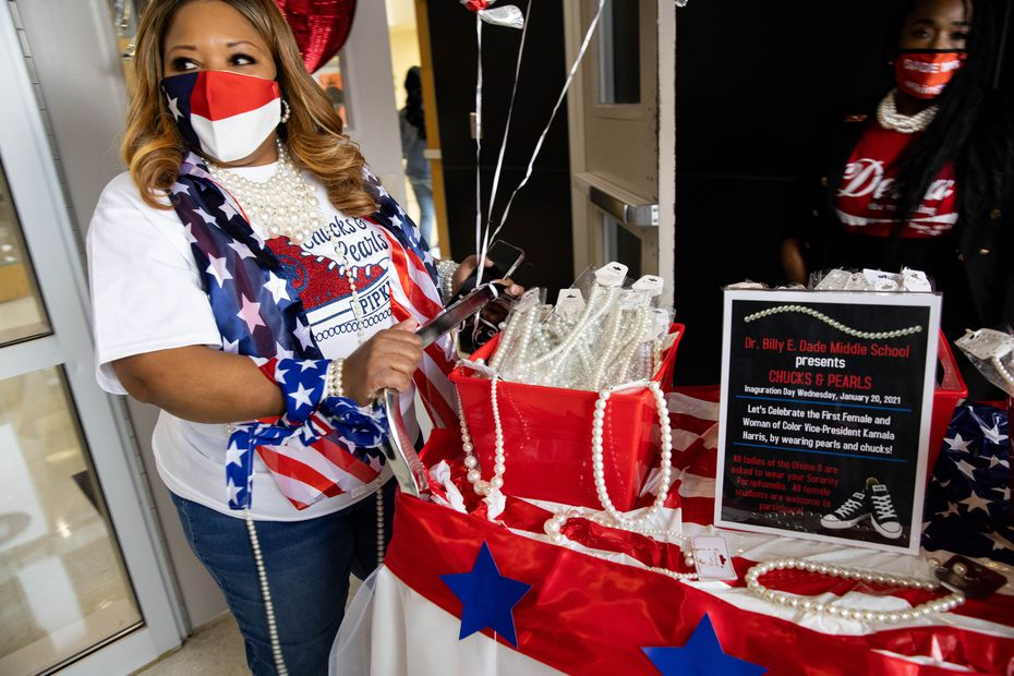 Campus Coordinator Vonda Pipkin pushes a cart of pearls at Billy Earl Dade Middle School in Dallas on Inauguration Day. Students and staff at the school wore Chucks and pearls to celebrate Kamala Harris, the first woman of color to become vice president.