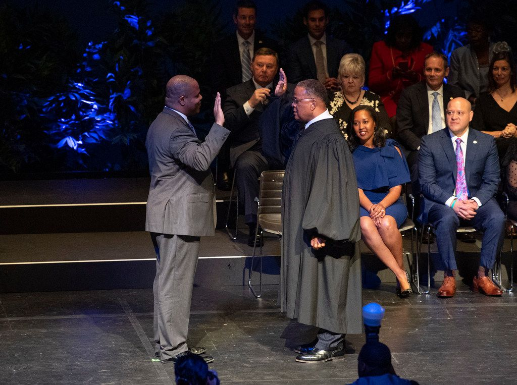 Eric Johnson takes the oath of office as he is sworn in as the new mayor of Dallas by District Judge Sam A. Lindsay on Monday at the Winspear Opera House in Dallas. (Jeffrey McWhorter/Special Contributor)