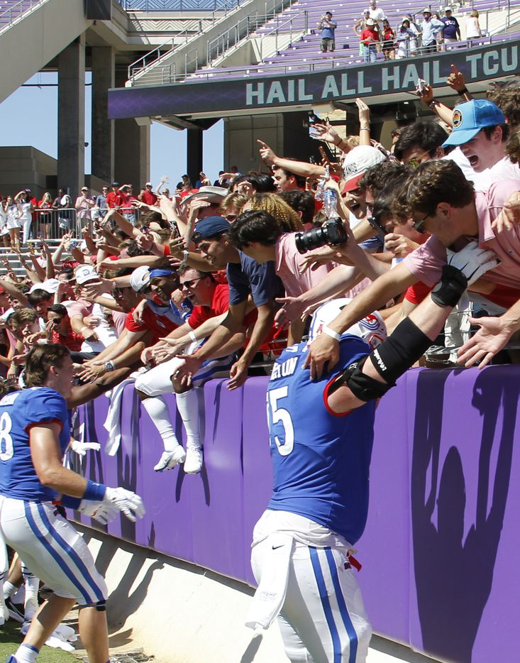 SMU offensive lineman Hayden Howerton (75) foreground, celebrates with fans following the Mustangs' 42-34 victory over TCU. The two teams played their NCAA football game at Amon G. Carter Stadium on the campus of TCU in Fort Worth on September 25, 2021. (Steve Hamm/ Special Contributor)