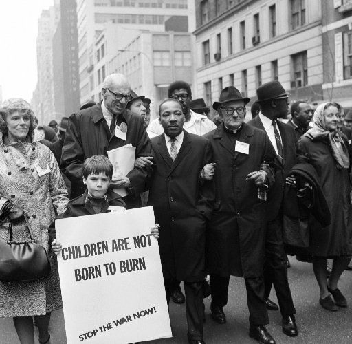 Civil rights leader Rev. Martin Luther King, Jr., (C) is accompanied by famed pediatrician Dr. Benjamin Spock (2nd-L), Father Frederick Reed (3rd-R) and union leader Cleveland Robinson (2nd-R) 16 March, 1967, during an anti-Vietnam War demonstration in New York.