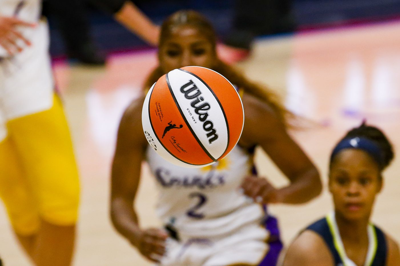 Players watch the ball during the fourth quarter of a Dallas Wings against the Los Angeles Sparks game at College Park Center on Tuesday, June 1, 2021, in Arlington. (Juan Figueroa/The Dallas Morning News)