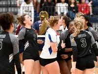 Denton Guyer players celebrate after a point during Tuesday's four-set win over Allen that clinched the District 5-6A title. (Matt Strasen/Special Contributor)