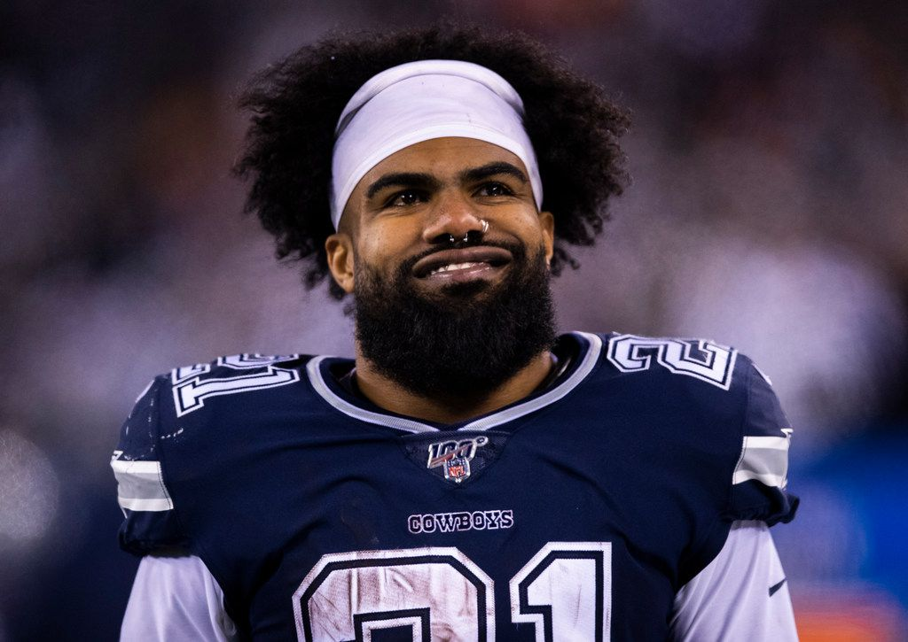 FILE - Cowboys running back Ezekiel Elliott (21) smiles after a touchdown in the fourth quarter of a game against the New York Giants on Monday, Nov. 4, 2019, at MetLife Stadium in East Rutherford, N.J.