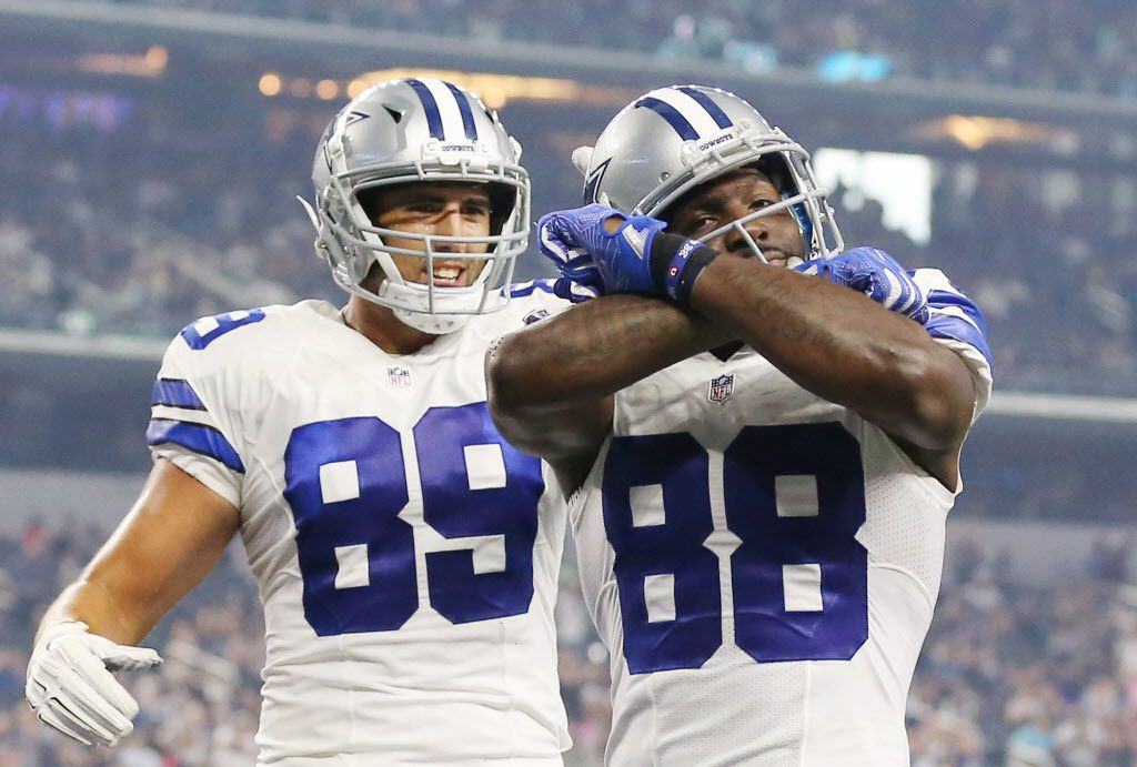 Dallas Cowboys tight end Gavin Escobar (89) celebrates with wide receiver Dez Bryant (88) after Bryant caught a pass from quarterback Dak Prescott (4) for a touchdown over the coverage of Miami Dolphins defensive back Byron Maxwell (41) in the second quarter to make the score 13-0 during a preseason National Football League game between the Miami Dolphins and the Dallas Cowboys at AT&T Stadium in Arlington, Texas Friday August 19, 2016. (Andy Jacobsohn/The Dallas Morning News)