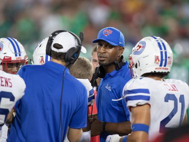 DALLAS, TX - SEPTEMBER 07: SMU Mustangs cornerbacks coach Kevin Curtis talks to his players during the college football game between the SMU Mustangs and North Texas Mean Green on September 07, 2019, at Gerald J. Ford Stadium in Dallas, TX.  (Photo by Matthew Visinsky/Icon Sportswire via Getty Images)
