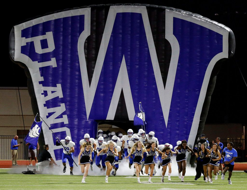The Plano West team and cheerleaders run onto the field through the team's giant blowup run-through before the start of a high school football game against Wylie at Wylie ISD Stadium in Wylie, Friday, October 13, 2017. (John F. Rhodes / Special Contributor)