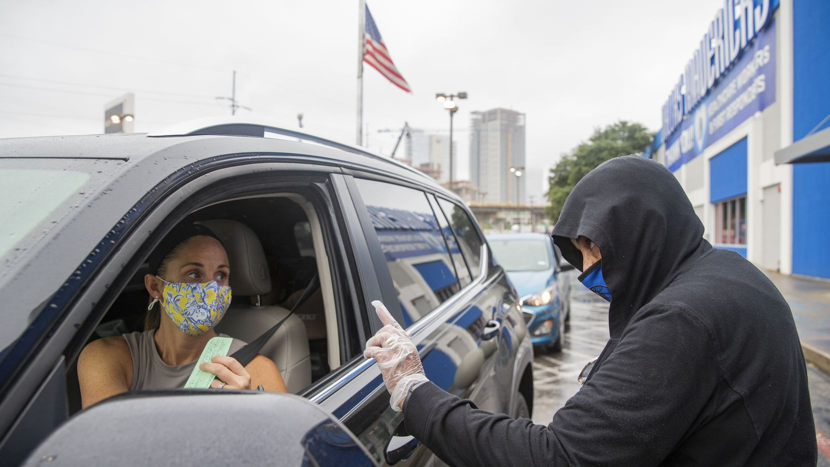 In this file photo, Alice Rice (left) finishes registering to vote with the help of Yvette Simmons at a Drive-Thru Voter Registration Event hosted by the Dallas Mavericks on Tuesday, Sept. 22, 2020 at the Dallas Mavericks Headquarters in Dallas.