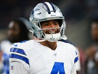 Dallas Cowboys quarterback Dak Prescott laughs as he warms up before an NFL preseason football game against the Tampa Bay Buccaneers at AT&T Stadium on Thursday, Aug. 29, 2019, in Arlington.