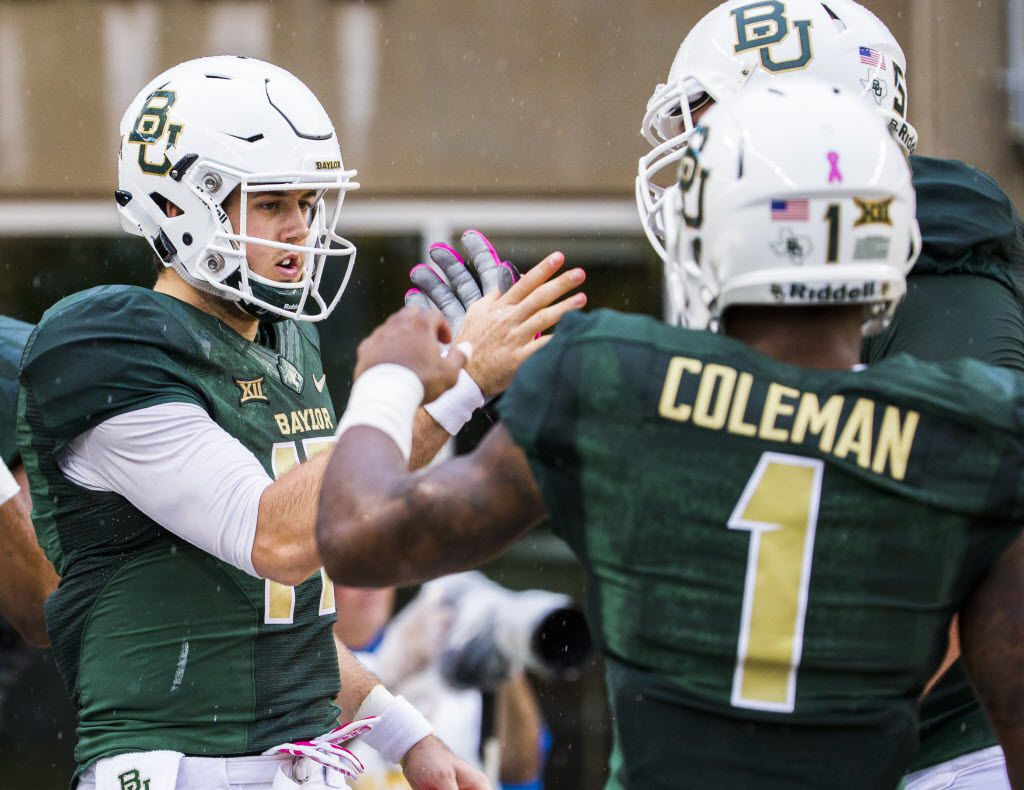 Baylor Bears quarterback Seth Russell (17) celebrates a touchdown with Baylor Bears wide receiver Corey Coleman (1) and Baylor Bears offensive tackle Spencer Drango (58) during the first half of their game against the Iowa State Cyclones on Saturday, October 24, 2015 at McClane Stadium in Waco, Texas.