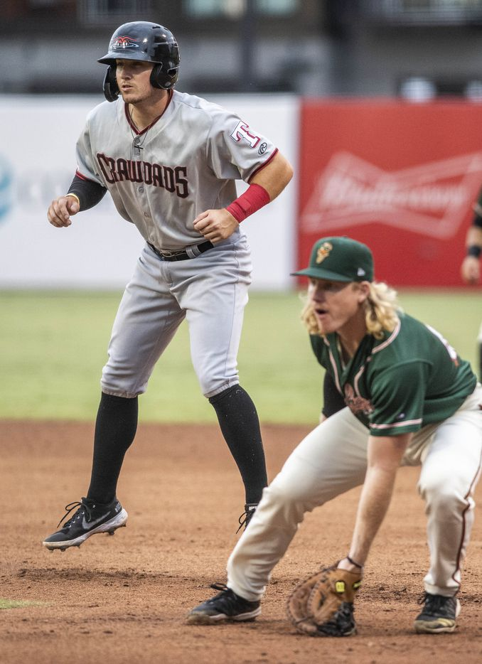 Hickory Crawdad's Trevor Hauver (33) takes a lead off first base during the game with the Greensboro Grasshopper's at First National Bank Field on Friday, August 6, 2021 in Greensboro, N.C. (Woody Marshall/Special Contributor)