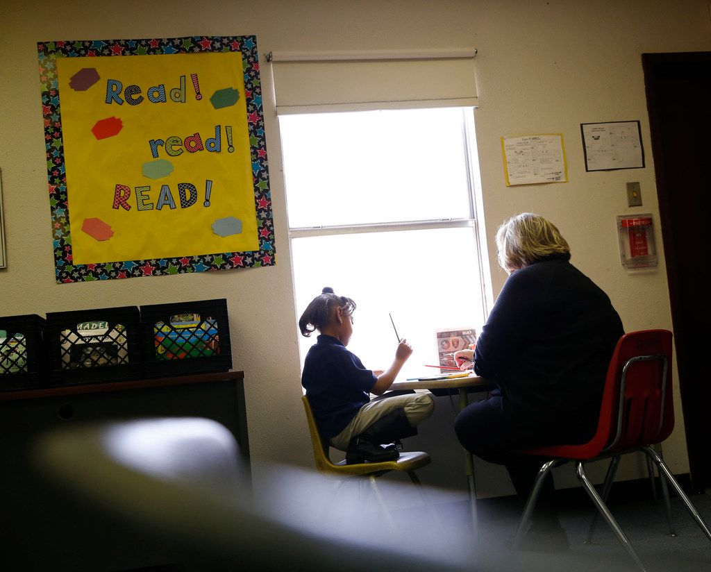 Beverly Funk, a First United Methodist Church volunteer, helps a student learn to read at J.J. Rhoads Learning Center in Dallas on Jan. 11, 2018 .  (Nathan Hunsinger/The Dallas Morning News)