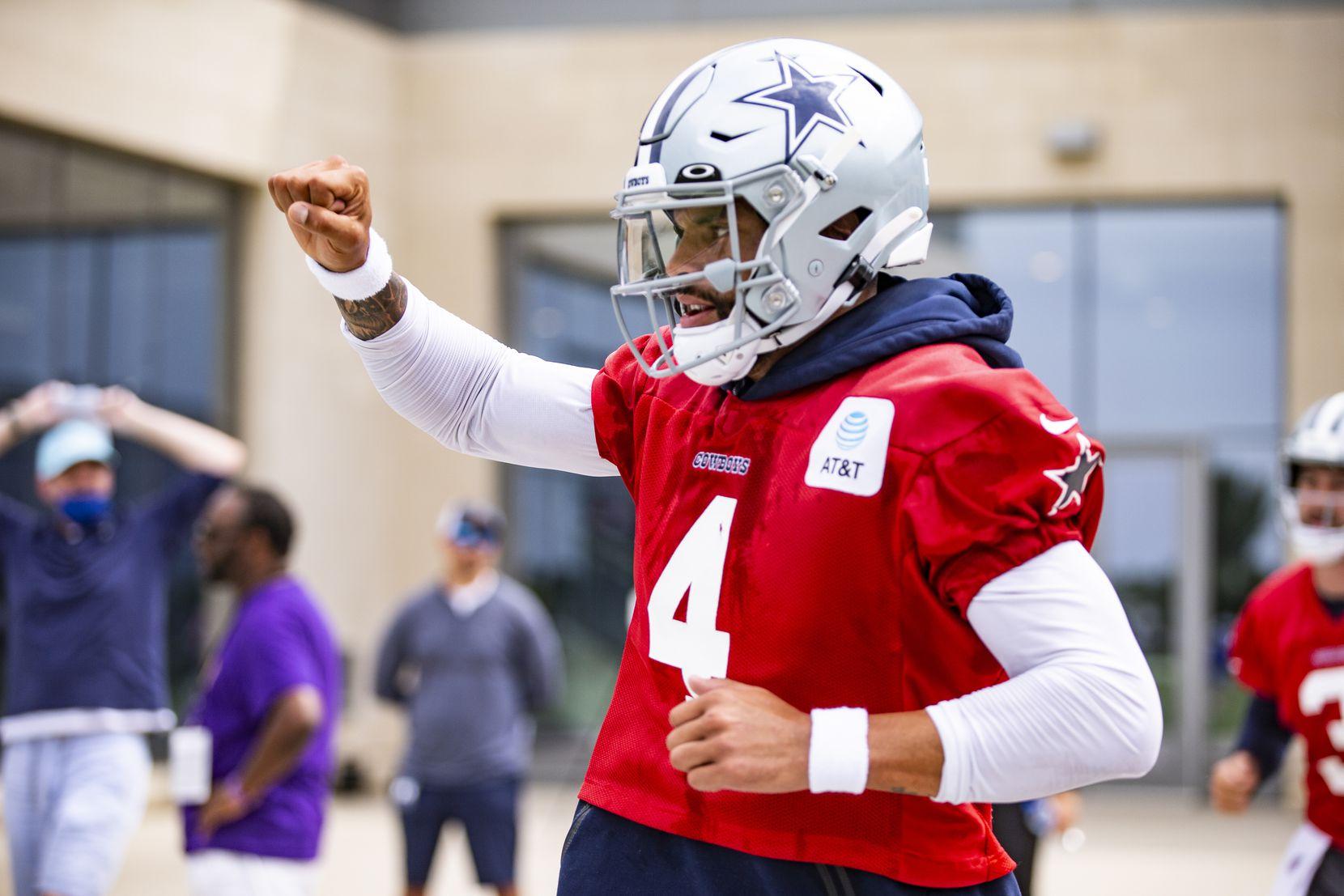 Dallas Cowboys quarterback Dak Prescott (4) runs onto the field during practice at The Star in Frisco, Sunday, September 5, 2021. (Brandon Wade/Special Contributor)