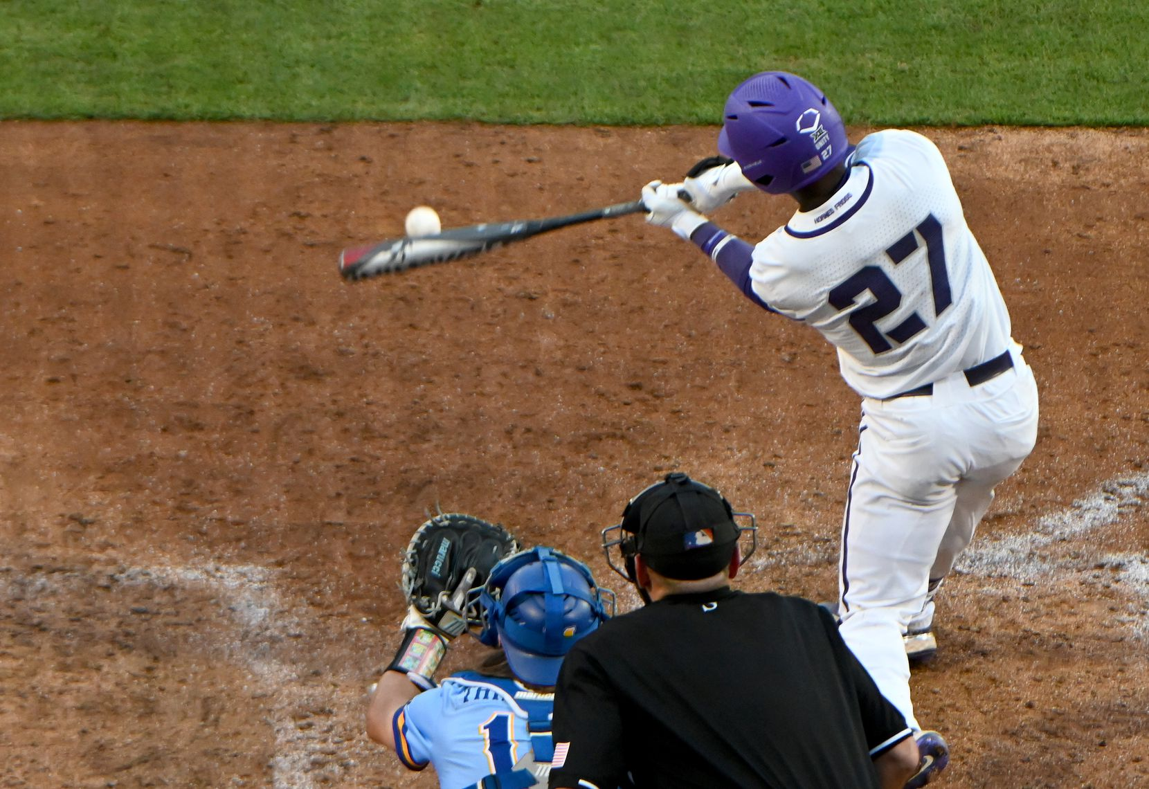 TCU outfielder Porter Brown (27) connects for a single to start the seventh inning of their game against against McNeese State in the Fort Worth Regional NCAA baseball tournament, Friday, June 4, 2021, in Fort Worth, Texas. (Matt Strasen/Special Contributor)