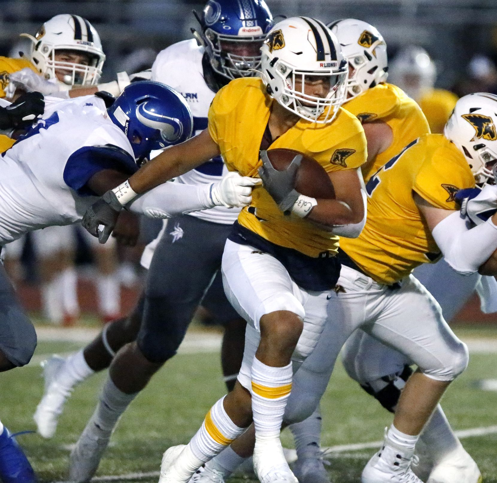 Prestonwood Christian Academy wide receiver Randell Holmes (7) is held up by the jersey as Nolan Catholic High School defensive end Curlee Thomas (9) was able to slow down the ball carrier during the first half as Prestonwood Christian Academy hosted Nolan Catholic High School at Lions Stadium in Plano on Friday night, October 9, 2020. (Stewart F. House/Special Contributor)