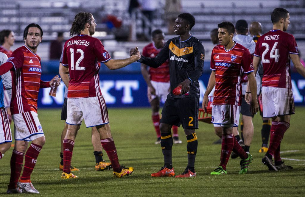 FC Dallas midfielder Ryan Hollingshead (12) shakes hands with Houston Dynamo defender Jalil Anibaba (2) after a 1-1 tie on Thursday, June 2, 2016 at Toyota Stadium in Frisco, Texas.  (Ashley Landis/The Dallas Morning News)