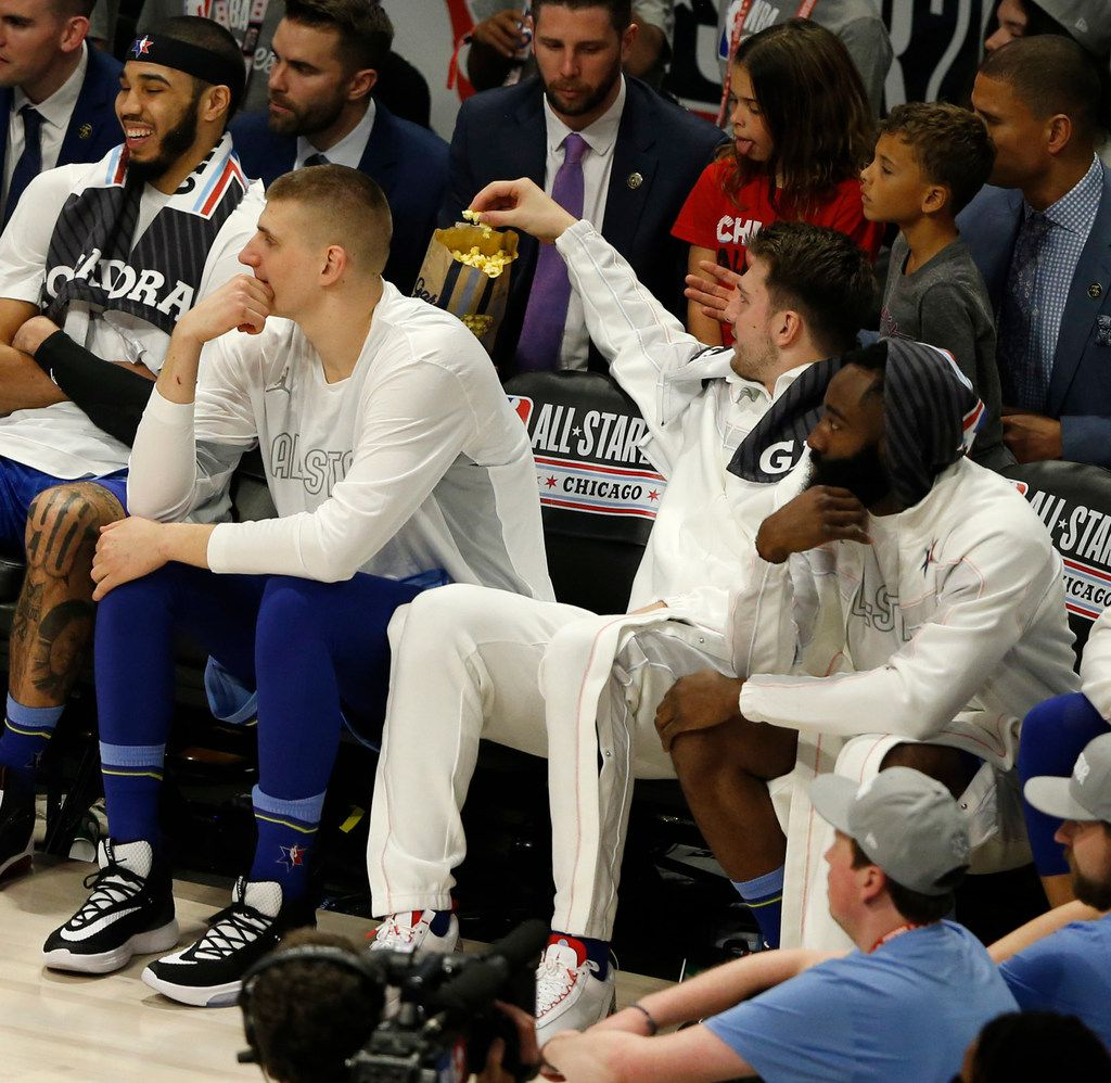Team LeBron's Luka Doncic (2) gets a handful of Garrett's popcorn on the bench during the first half of play in the NBA All-Star 2020 game at United Center in Chicago on Sunday, February 16, 2020. (Vernon Bryant/The Dallas Morning News)