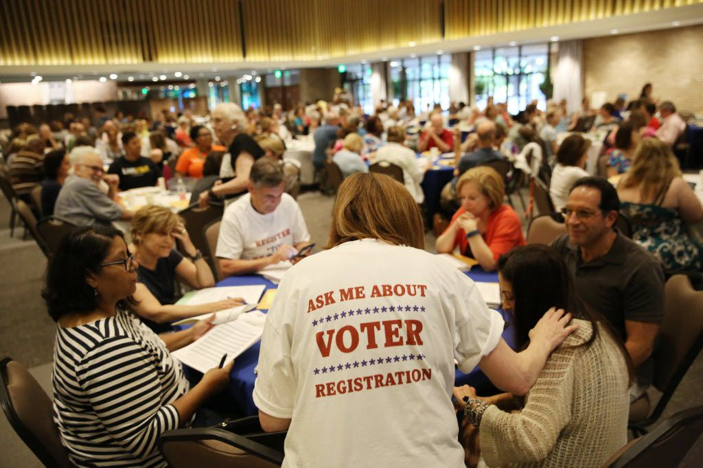 Nancy Lubar collects registration cards during a deputy voter registrar class hosted by Faith in Texas and instructed by Robert Heard, assistant elections administrator for Dallas County Elections, at Temple Emanu-El in Dallas on Aug. 11, 2016.