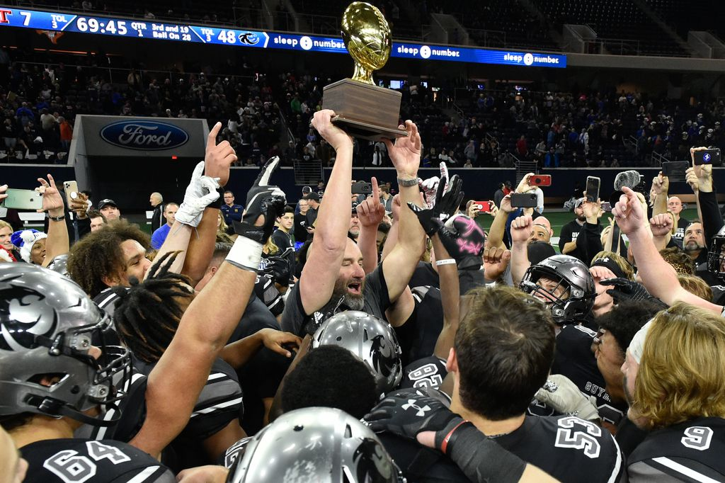 The Guyer football team celebrates after they defeat Tascosa 48-7 at the Ford Center at the Star, Dec. 7, 2019, in Frisco, Texas.