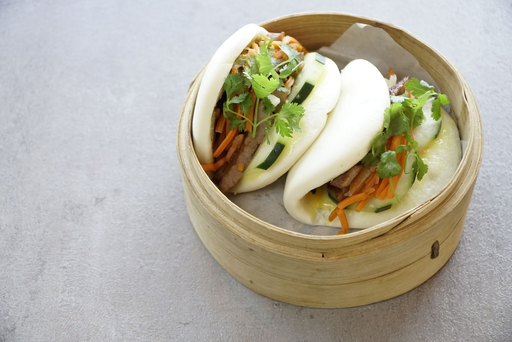 Banh Mi Bao is a popular dish at Four Sisters Restaurant in Fort Worth.