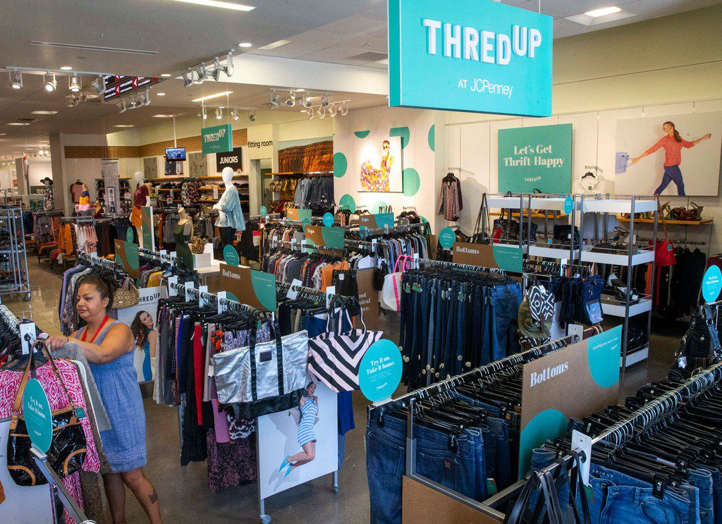 J.C. Penney employee Perla Valdivia racks clothes in the thredUP section at J.C. Penney inside the Timber Creek Crossing shopping center in Dallas on Tuesday, August 20, 2019.  J.C. Penney and many other traditional retailers are turning to partnerships with companies like thredUP to add used clothing to their mix. ThredUP is a resale website for costumers buying secondhand clothings.  (Shaban Athuman/Staff Photographer)