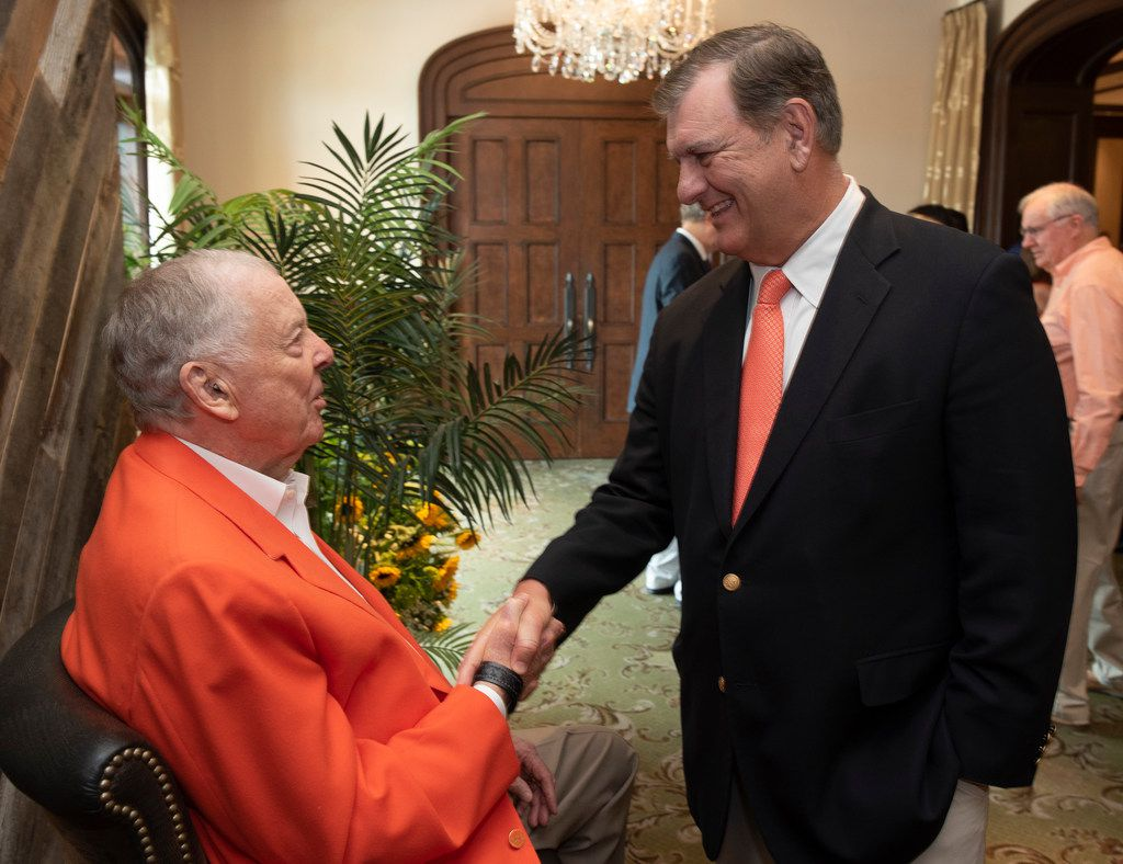 T. Boone Pickens, left, greets Dallas Mayor Mike Rawlings  at his 90th birthday party Saturday.