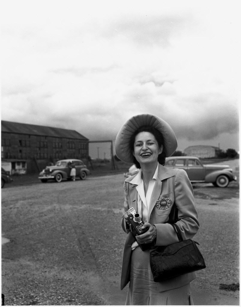 In this June 19, 1941 photo provided by the LBJ Library, Lady Bird Johnson holds her movie camera in central Texas.