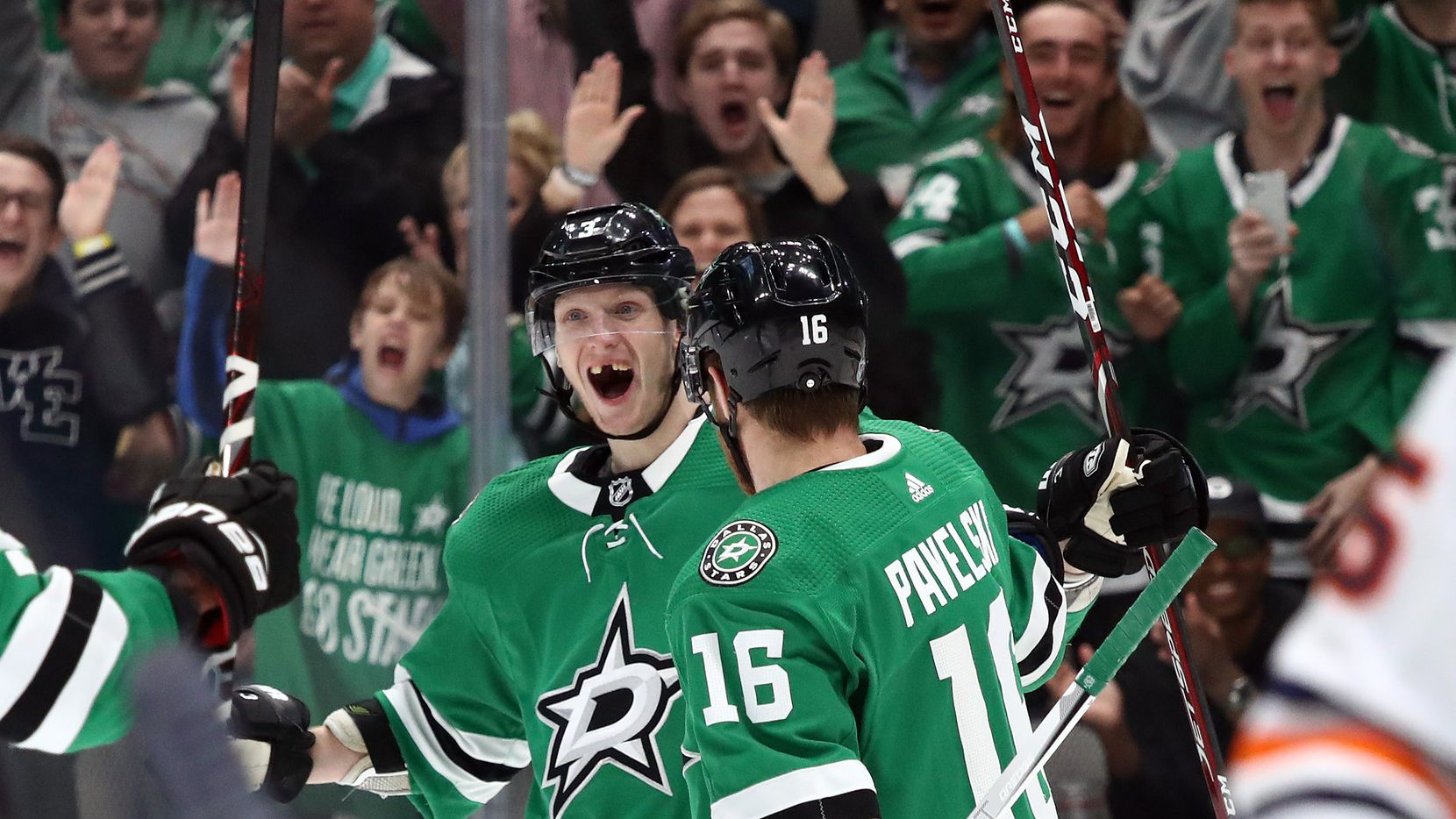 DALLAS, TEXAS - MARCH 03:  John Klingberg #3 of the Dallas Stars celebrates his goal with Joe Pavelski #16 in the third period against the Edmonton Oilers at American Airlines Center on March 03, 2020 in Dallas, Texas.