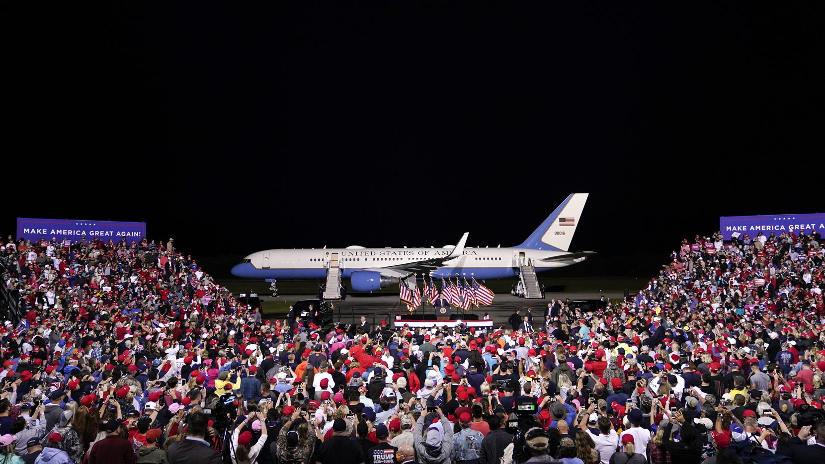 With Air Force One behind him, President Donald Trump campaigns at a rally that drew thousands of supporters to Newport News/Williamsburg International Airport on Sept. 25, 2020 in Newport News, Va.