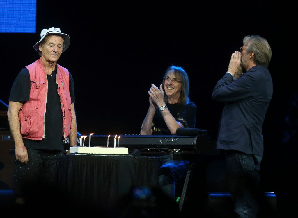Eric Clapton (far right) presents a birthday cake to actor, comedian and event emcee Bill Murray during the Crossroads Guitar Festival on Saturday, Sept. 22, 2019 at the American Airlines Center in downtown Dallas.