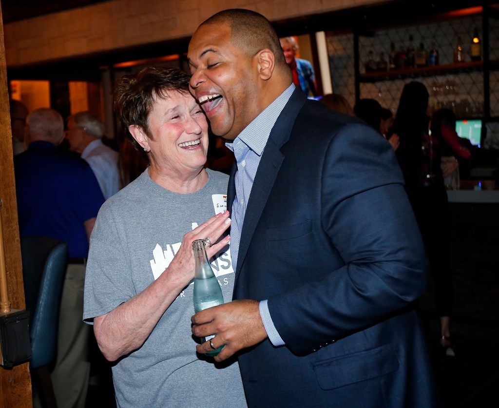 Dallas mayoral candidate and current state Rep. Eric Johnson is congratulated by his elementary and middle school teacher Elaine Velvin during an election night party at Smoky Rose restaurant.