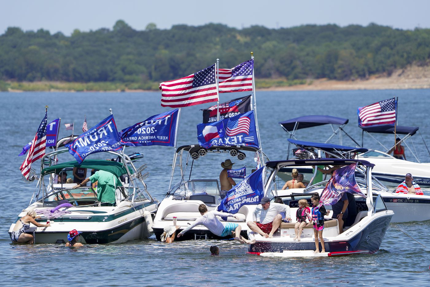 Boaters gather in support of President Donald Trump for a rally and boat parade at Oak Grove Park on Grapevine Lake on Saturday, Aug. 15, 2020.