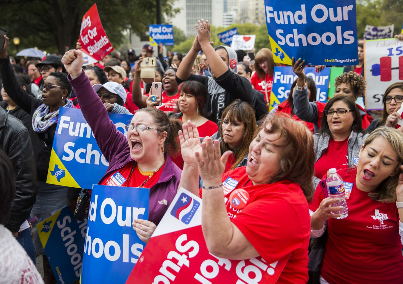 Lindsey Mayes (center left) and Virginia Garrobo (center right), both fourth grade teachers from Houston, cheer during the Texas Public Education Rally on Monday, March 11, 2019 at the Texas capitol in Austin. Teachers pushed for school finance reform and pay raises.