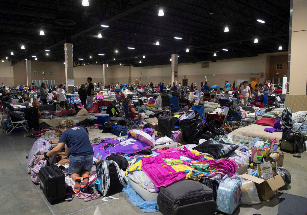 Hundreds of people gathered Friday in an emergency shelter at the Miami-Dade County Fair Expo Center in Miami, ahead of Hurricane Irma. Florida Gov. Rick Scott warned that all of the state's 20 million residents should be prepared to evacuate as Hurricane Irma bears down for a direct hit.