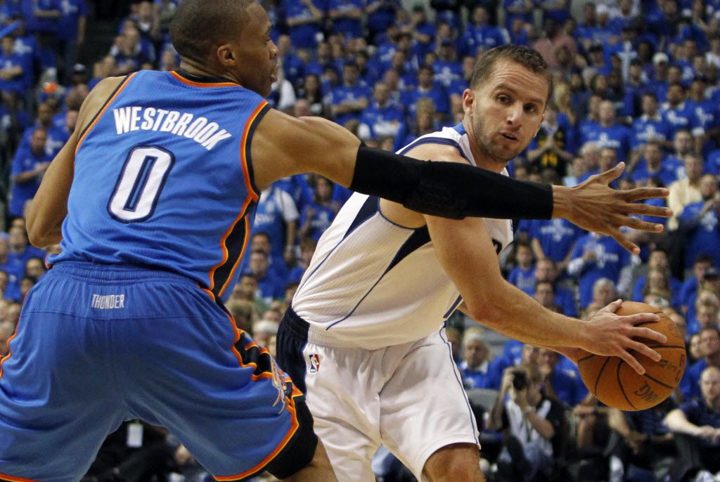 Dallas' JJ Barea passes around OKC's Russell Westbrook during the fourth period of play in Game 1 of the NBA Western Conference Finals at American Airlines Center in Dallas on May 17, 2011. The Mavericks won 121-112 to take a 1-0 lead in the series.  (Louis DeLuca/The Dallas Morning News)