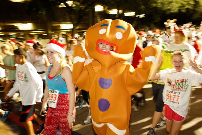 Festive runners take the streets for the Jingle Bell Run outside the Hilton Anatole.