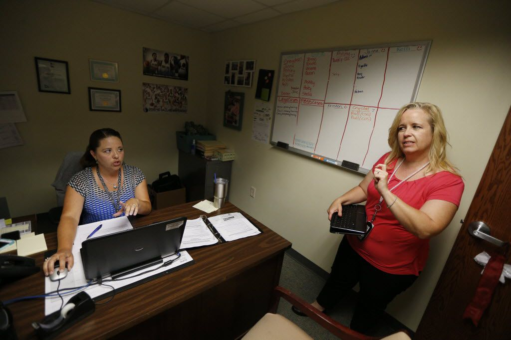 Tarrant County CPS child abuse investigator Kelli Bailey (right) talked to her supervisor, Denee Borchardt, about a new case last summer. (Nathan Hunsinger/Staff Photographer)